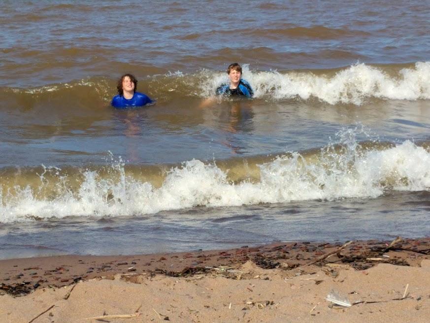 Lake. Beach on the big sandbar. Cousin Elijah. Happy Paco. Simple math.