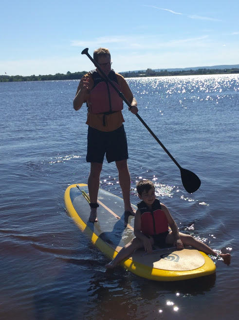 """John doesn't mind Uncle Byron, either. It was great fun to introduce the Turks to paddle boarding — the same way they introduced us to the concept of sitting on a picnic blanket in front of the television and eating """"durum."""" Mmmmm. Durum."""