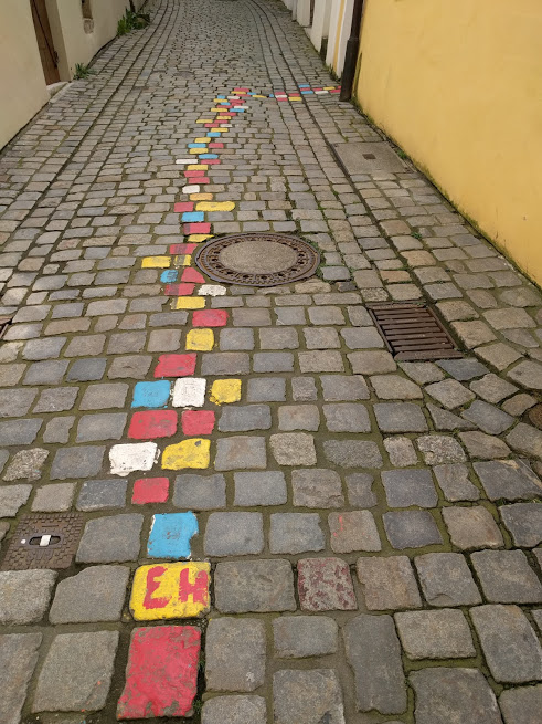 This is from the artists' alley in Passau, where colorful cobbles lead people to the doors of artists.