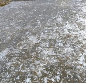 Sheet of ice on sidewalk